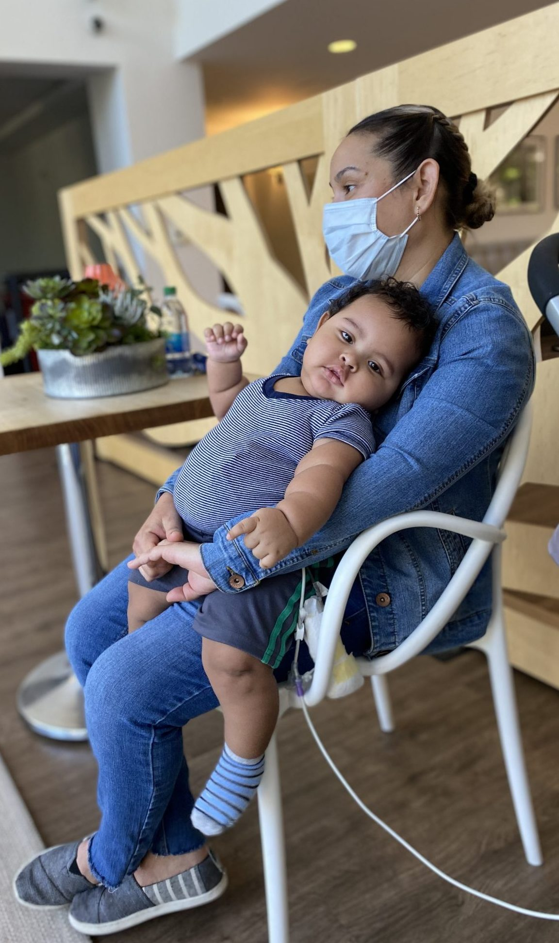 Emilio sitting on his mom Maricela's lap