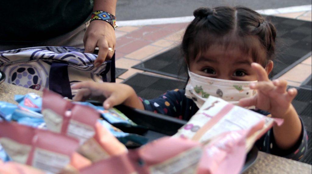Silbing at Oakland Children's reaches for snacks