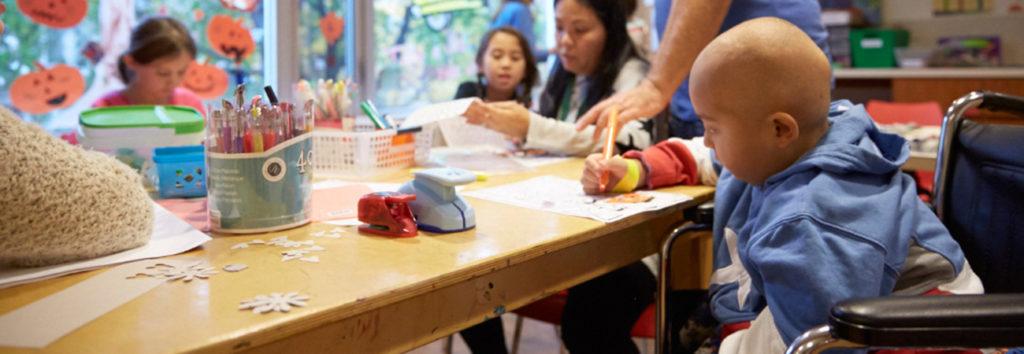 Children coloring with volunteers