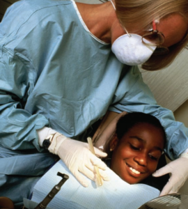 A child visits the Ronald McDonald Care Mobile for a dental check up