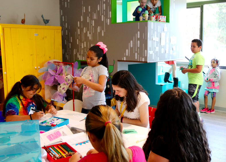 Children work on an arts and crafts activity