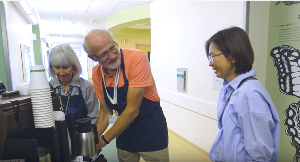 Couple volunteering in the hospital, passing out coffee